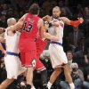 New York Knicks\' Jason Kidd, left, and Chicago Bulls\' Kirk Hinrich, second from right, separate Bulls\' Joakim Noah (13) and Knicks\' Tyson Chandler, right, during the second half of an NBA basketball game on Friday, Dec. 21, 2012, at Madison Square Garden in New York. The Bulls defeated the Knicks 110-96. (AP Photo/Mary Altaffer)