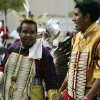 Brad Ware (Wichita), right, from Fort Duchesne, Utah, was running late this morning and was not able to put on his full regalia before joining the parade, but he and friend Tony Weryackwe (Comanche and Iowa), left, from Anadarko, Oklahoma, will compete in the Northern Traditional dance competition