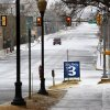 A white Christmas in downtown Oklahoma City, Dec. 25, 2012. A lone vehicle travels on a snow-covered NW 4th, seen looking west from Harvey. Photo by Jim Beckel, The Oklahoman