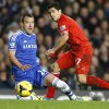 Photo - Chelsea's John Terry, left, vies for the ball with Liverpool's Luis Suarez during the English Premier League soccer match between Chelsea and Liverpool at Stamford Bridge Stadium in London, Sunday, Dec. 29, 2013. (AP Photo/Kirsty Wigglesworth)