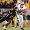 Kansas State wide receiver Tyler Lockett (16) avoids a tackle by West Virginia\'s Karl Joseph (8) after a pass from quarterback Collin Klein during the first quarter of an NCAA college football game in Morgantown, W.Va., Saturday, Oct. 20, 2012. (AP Photo/Christopher Jackson) ORG XMIT: WVCJ101