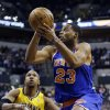 New York Knicks\' Marcus Camby (23) goes to the basket against Indiana Pacers\' David West (21) during the first half of an NBA basketball game, Thursday, Jan. 10, 2013, in Indianapolis. (AP Photo/Darron Cummings)