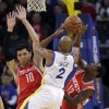 Golden State Warriors\' Jarrett Jack (2) tries to shoot in front of Houston Rockets\' Carlos Delfino (10) and Patrick Beverley (12) during the first half of an NBA basketball game in Oakland, Calif., Tuesday, Feb. 12, 2013. (AP Photo/Marcio Jose Sanchez)