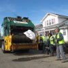 A Nov. 5, 2012 photo shows public works employees tossing waterlogged bedding into a garbage truck in Point Pleasant Beach N.J. a week after Superstorm Sandy roared through. Debris disposal costs are a major expense for towns that were hard hit by the storm. Even with federal reimbursement for much of the cleanup and rebuilding expenses, these towns could be facing property tax hikes next year as a result of the unexpected costs, and the loss of millions of dollars of taxable property. (AP Photo/Wayne Parry)