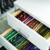 Photo - Kevin Starkey's tie drawer reflects the mantra that you must see to use. Ties stacked flat in this drawer rather than on their sides would be less accessible.  Photo provided by Johnny Miller  for The Best of Martha Stewart Living Organizing