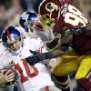 Photo - New York Giants quarterback Eli Manning (10) is sacked by Washington Redskins outside linebacker Brian Orakpo (98) during the second half of an NFL football game Sunday, Dec. 1, 2013, in Landover, Md. (AP Photo/Patrick Semansky)