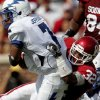 OU\'s Jamell Fleming brings down Tim Jefferson of Air Force during the first half of the college football game between the University of Oklahoma Sooners (OU) and Air Force (AF) at the Gaylord Family-Oklahoma Memorial Stadium on Saturday, Sept. 18, 2010, in Norman, Okla. Photo by Bryan Terry, The Oklahoman