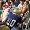 Oklahoma\'s Julian Wilson (2) intercepts a pass next to Notre Dame\'s DaVaris Daniels (10) in the second quarter during a college football game between the University of Oklahoma Sooners (OU) and the Notre Dame Fighting Irish at Notre Dame Stadium in South Bend, Ind., Saturday, Sept. 28, 2013. Photo by Nate Billings, The Oklahoman