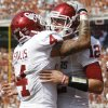 Oklahoma\'s Landry Jones (12) celebrates with Oklahoma\'s Kenny Stills (4) during the Red River Rivalry college football game between the University of Oklahoma Sooners (OU) and the University of Texas Longhorns (UT) at the Cotton Bowl in Dallas, Saturday, Oct. 8, 2011. Photo by Bryan Terry, The Oklahoman