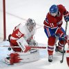 Photo - Montreal Canadiens right wing Brendan Gallagher (11) is stopped by Detroit Red Wings goalie Jimmy Howard (35) during the first period of an NHL hockey game Wednesday, Feb. 26, 2014, in Montreal. (AP Photo/The Canadian Press, Ryan Remiorz)