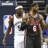 Photo - Miami Heat forward LeBron James (6) reacts to an official's call in the first half of an NBA basketball game Wednesday, April 9, 2014, in Memphis, Tenn. At left is Memphis Grizzlies forward Zach Randolph (50). (AP Photo/Mark Humphrey)