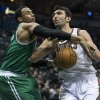 Boston Celtics\' Jared Sullinger, left, strips the ball from Milwaukee Bucks\' Zaza Pachulia during the second half of an NBA basketball game, Monday, Feb. 10, 2014, in Milwaukee. (AP Photo/Tom Lynn)