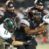 Norman North\'s DJ Gasso brings down Westmoore\'s Kieron Hardrick during a high school football game in Moore, Okla., Thursday, September 13, 2012. Photo by Bryan Terry, The Oklahoman