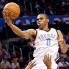 Oklahoma City\'s Russell Westbrook puts up a shot over Toronto\'s Jarrett Jack during their NBA basketball game at the Ford Center in Oklahoma City on Sunday, Feb. 28, 2010. The Thunder beat the Raptors 119-99. Photo by John Clanton, The Oklahoman