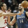 Chicago Bulls center Joakim Noah (13), left, passes against Minnesota Timberwolves center Nikola Pekovic (14) during the first half of an NBA basketball game in Chicago on Saturday, Nov. 10, 2012. (AP Photo/Nam Y. Huh)