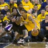Indiana Pacers\' George Hill works the ball inside against Sacramento Kings\' Aaron Brooks during an NBA basketball game in Indianapolis on Saturday, Nov. 3, 2012. (AP Photo/Doug McSchooler)
