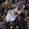 Golden State Warriors\' Carl Landry (7) drives the ball away from Atlanta Hawks\' Josh Smith during the first half of an NBA basketball game Wednesday, Nov. 14, 2012, in Oakland, Calif. (AP Photo/Ben Margot)