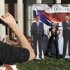 Ellen Leslie, left, takes a photo of Danielle Gillespie, right, with cardboard cut-outs of Mitt Romney and President Barack Obama at DebateFest at the University of Denver on Wednesday, Oct. 3, 2012, in Denver. (AP Photo/Chris Schneider)