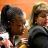 Photo - Sybrina Fulton, left, mother of slain teen Trayvon Martin, talks with State Attorney Angela Corey during the George Zimmerman trial in Seminole circuit court in Sanford, Fla., Monday, June 17, 2013. Zimmerman has been charged with second-degree murder for the 2012 shooting death of Trayvon Martin.(AP Photo/Orlando Sentinel, Joe Burbank, Pool)