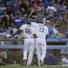 Los Angeles Dodgers\' Hanley Ramirez, right, celebrates his two-run home run with Yasiel Puig against the Pittsburgh Pirates during fourth inning of a baseball in Los Angeles, Saturday, May 31, 2014. (AP Photo/Chris Carlson)