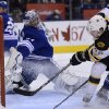 Photo - Boston Bruins left wing Chris Bourque scores on Toronto Maple Leafs goalie James Reimer during the first period of an NHL hockey game in Toronto on Saturday, Feb. 2, 2013. (AP Photo/The Canadian Press, Frank Gunn)