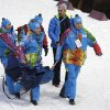 Photo - France's Marie Laure Brunet is carried away after crashing during the women's biathlon 4x6k relay at the 2014 Winter Olympics, Friday, Feb. 21, 2014, in Krasnaya Polyana, Russia. (AP Photo/Lee Jin-man)