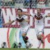 Photo - Germany's Mats Hummels (5) and teammate Benedikt Hoewedes (4) celebrate Hummels' goal during the group G World Cup soccer match between Germany and Portugal at the Arena Fonte Nova in Salvador, Brazil, Monday, June 16, 2014.  (AP Photo/Natacha Pisarenko)