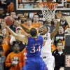 Oklahoma State \'s Kamari Murphy (21) blocks a shot by Kansas\' Perry Ellis (34) during the college basketball game between the Oklahoma State University Cowboys (OSU) and the University of Kanas Jayhawks (KU) at Gallagher-Iba Arena on Wednesday, Feb. 20, 2013, in Stillwater, Okla. Photo by Chris Landsberger, The Oklahoman