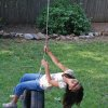 Eight-year-old Grace Mathew, my niece, enjoys swinging on a tire swing in my backyard. Community Photo By: Cindi Tennison Submitted By: Cindi , Bethany