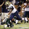 Southmoore\'s Karltrell Henderson (27) gets tripped up on a run during a high school football game between Edmond Santa Fe and Southmoore at Wantland Stadium in Edmond, Okla., Thursday, Sept. 20, 2012. Photo by Nate Billings, The Oklahoman