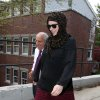 Photo - Katherine Russell, right, wife of Boston Marathon bomber suspect Tamerlan Tsarnaev, leaves the law office of DeLuca and Weizenbaum with Amato DeLuca, left, Monday, April 29, 2013, in Providence, R.I. (AP Photo/Stew Milne)