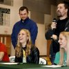 Athletes Emily Hart and her sister, Erin Hart, and Stephen Snider, far left, laugh at comments made by their coach when introducing the Hart sisters to the audience before a group of Edmond Santa Fe seniors signed their letters. Erin and Emily Hart signed letters to participate in track and field at Oklahoma Baptist University in Shawnee. Snider signed a letter to participate in cross country and track and field at William Jewell College during signing day ceremony in the gymnasium at Edmond Santa Fe High School on Wednesday, Feb. 5, 2014. Photo by Jim Beckel, The Oklahoman