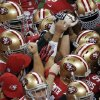 San Francisco 49ers players huddle before the NFL Super Bowl XLVII football game against the Baltimore Ravens, Sunday, Feb. 3, 2013, in New Orleans. (AP Photo/Charlie Riedel)