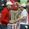 Europe\'s Rory McIlroy, right, shakes hands with USA\'s Keegan Bradley before a singles match at the Ryder Cup PGA golf tournament Sunday, Sept. 30, 2012, at the Medinah Country Club in Medinah, Ill. (AP Photo/Charles Rex Arbogast) ORG XMIT: PGA105