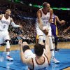 L.A. LAKERS / REACTION: Oklahoma City\'s Kevin Durant (35) helps Nick Collison (4) up after he took a charge from Los Angeles\' Devin Ebanks (3) as Oklahoma City\'s Russell Westbrook (0) reacts during an NBA basketball game between the Oklahoma City Thunder and the Los Angeles Lakers at Chesapeake Energy Arena in Oklahoma City, Friday, Dec. 7, 2012. Oklahoma City won, 114-108. Photo by Nate Billings, The Oklahoman