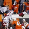 Oklahoma quarterback Sam Bradford (14) is flipped upside down as he leaps over Oklahoma State\'s Orie Lemon (41) during the second half of the college football game between the University of Oklahoma Sooners (OU) and Oklahoma State University Cowboys (OSU) at Boone Pickens Stadium on Saturday, Nov. 29, 2008, in Stillwater, Okla. STAFF PHOTO BY CHRIS LANDSBERGER