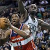 Photo -   Washington Wizards forward Kevin Seraphin (13) drives to the basket past Boston Celtics forward Kevin Garnett during the first half of an NBA basketball game in Boston on Wednesday, Nov. 7, 2012. (AP Photo/Elise Amendola)