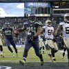 Photo - Seattle Seahawks running back Marshawn Lynch (24) arrives in the end zone with a 31-yard touchdown during the fourth quarter of an NFC divisional playoff NFL football game against the New Orleans Saints in Seattle, Saturday, Jan. 11, 2014. (AP Photo/John Froschauer)