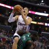 Los Angeles Clippers\' Blake Griffin, top, shoots over Boston Celtics\' Brandon Bass in the first half of an NBA basketball game in Los Angeles, Thursday, Dec. 27, 2012. (AP Photo/Jae C. Hong)