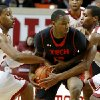 Oklahoma\'s Steven Pledger, left, and Oklahoma\'s Buddy Hield defend Texas Tech\'s Daylen Robinson (10) during an NCAA college basketball game between the University of Oklahoma and Texas Tech University at Lloyd Noble Center in Norman, Okla., Wednesday, Jan. 16, 2013. Photo by Bryan Terry, The Oklahoman
