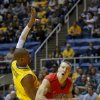 Radford\'s Lucas Dyer, right, is fouled by West Virginia\'s Dominique Rutledge, left, during the first half of an NCAA college basketball game at WVU Coliseum in Morgantown, W.Va., on Saturday, Dec. 22, 2012. (AP Photo/David Smith)