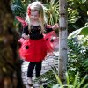Photo - Maggie Richards watches a ladybug crawl on her hand Tuesday during the ladybug release at the Myriad Botanical Gardens in Oklahoma City. Photo by Chris Landsberger, The Oklahoman  CHRIS LANDSBERGER - CHRIS LANDSBERGER