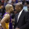 Los Angeles Lakers head coach Mike Brown, right, talks to point guard Derek Fisher in the fourth quarter of an NBA basketball game against the Washington Wizards at the Verizon Center in Washington, Wednesday, March 7, 2012. The Wizards won 106-101. (AP Photo/Jacquelyn Martin)