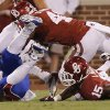 OU\'s Lamar Harris (15) and Eric Striker (41) bring down KU\'s Michael Cummings (14) during the college football game between the University of Oklahoma Sooners (OU) and the University of Kansas Jayhawks (KU) at Gaylord Family-Oklahoma Memorial Stadium on Saturday, Oct. 20th, 2012, in Norman, Okla. Photo by Chris Landsberger, The Oklahoman
