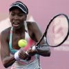 Photo - In this photo released by Foto Arena, U.S. tennis player Venus Williams returns the ball to Russia's Olga Puchkova during a WTA Brasil Tennis Cup semifinal game in Florianopolis, Brazil, Friday, March 1, 2013.  Puchkova won 2-1. (AP Photo/Cristiano Andujar, Foto Arena)