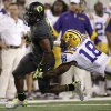 Oregon running back LaMichael James, left, attempts to escape a tackle by LSU\'s Brandon Taylor (18) in the first half of the Cowboys Classic NCAA college football game Saturday, Sept. 3, 2011, in Arlington, Texas. (AP Photo/Tony Gutierrez) ORG XMIT: CBS126