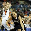 Kiowa\'s Lauren Smith (20) drives past Cheyenne-Reydon\'s Summer Pennington (30) during a Class A girls semifinal game of the state high school basketball tournament between Cheyenne-Reydon and Kiowa at Jim Norick Arena, The Big House, on State Fair Park in Oklahoma City, Friday, March 1, 2013. Photo by Nate Billings, The Oklahoman