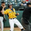 West Virginia\'s Bobby Boyd (4) reacts in front of Oklahoma State pitcher Brendan McCurry (4) after being called safe by umpire Mike Morris on a slide at home plate to score the winning run in the tenth inning during an NCAA baseball game between Oklahoma State and West Virginia in the Big 12 Baseball Championship tournament at the Chickasaw Bricktown Ballpark in Oklahoma City, Saturday, May 25, 2013. WVU beat OSU 6-5 in ten innings. Photo by Nate Billings, The Oklahoman