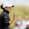 Photo - Mo Martin of the US gestures to the crowd at the 9th green during the final day of the Women's British Open golf championship at the Royal Birkdale Golf Club, in Southport, England, Sunday, July 13, 2014. (AP Photo/Scott Heppell)