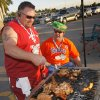 OU fan Johnny Lane, left, and Florida fan David Baghdassarian, both of Coral Springs, Fla., talk while tailgating together before the BCS National Championship college football game between the University of Oklahoma Sooners (OU) and the University of Florida Gators (UF) on Thursday, Jan. 8, 2009, at Dolphin Stadium in Miami Gardens, Fla. Lane is originally from Ardmore, Okla. The two are best friends who typically root for each other\'s team until this game where the two teams are playing for the first time. PHOTO BY NATE BILLINGS, THE OKLAHOMAN